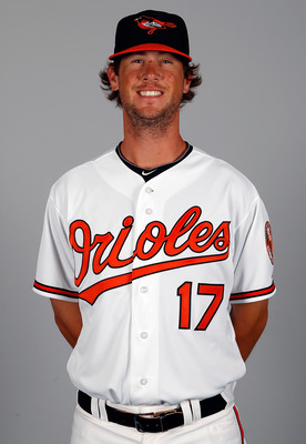 SARASOTA, FL - FEBRUARY 26:  Pitcher Brian Matusz #17 of the Baltimore Orioles poses for a photo during photo day at Ed Smith Stadium on February 26, 2011 in Sarasota, Florida.  (Photo by J. Meric/Getty Images)