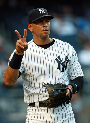 A-Rod giving the peace sign to his wanna-be best friend--Derek Jeter.
