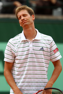 PARIS, FRANCE - MAY 26:  Florian Mayer of Germany shows his dejection during the men's singles round two match between Alejandro Falla of Columbia and Florian Mayer of Germany on day five of the French Open at Roland Garros on May 26, 2011 in Paris, Franc