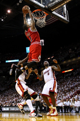 MIAMI, FL - MAY 24:  Derrick Rose #1 of the Chicago Bulls goes up for a dunk against Udonis Haslem #40 and LeBron James #6 of the Miami Heat in the first half of Game Four of the Eastern Conference Finals during the 2011 NBA Playoffs on May 24, 2011 at Am