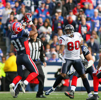 ORCHARD PARK, NY - NOVEMBER 01: Jairus Byrd #31 of the Buffalo Bills intercepts a pass that deflected off of Andre Johnson #80 of the Houston Texans at Ralph Wilson Stadium on November 1, 2009 in Orchard Park, New York.  (Photo by Rick Stewart/Getty Image