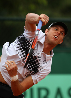 PARIS, FRANCE - MAY 26:  Sam Querrey of USA serves during the men's singles round two match between Sam Querrey of USA and Ivan Lubicic of Croatia on day five of the French Open at Roland Garros on May 26, 2011 in Paris, France.  (Photo by Alex Livesey/Ge