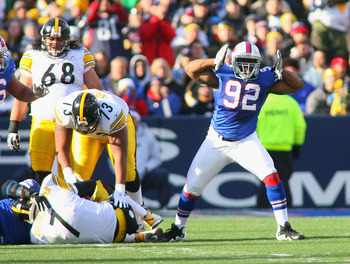 ORCHARD PARK, NY - NOVEMBER 28: Alex Carrington #92 of the Buffalo Bills reacts after sacking Ben Roethlisberger #7 of the Pittsburgh Steelers at Ralph Wilson Stadium at Ralph Wilson Stadium on November 28, 2010 in Orchard Park, New York.  (Photo by Rick