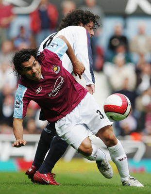 LONDON - MAY 05:  Carlos Tevez (L) of West Ham United is challenged by Ivan Campo (R) of Bolton Wanderers during the Barclays Premiership match between West Ham United and Bolton Wanderers at Upton Park on May 5, 2007 in London, England.  (Photo by Christ