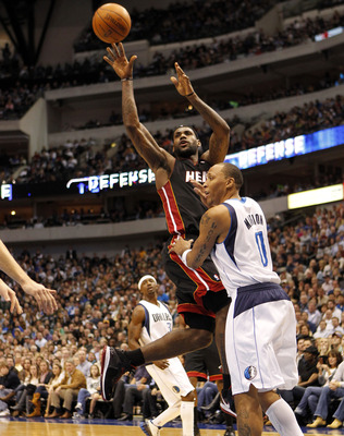 DALLAS - NOVEMBER 27: Lebron James #6 of the Miami Heat shoots over Shawn Marion #0 of the Dallas Mavericks on November 27, 2010 at the American Airlines Center in Dallas, Texas. NOTE TO USER: User expressly acknowledges and agrees that, by downloading an