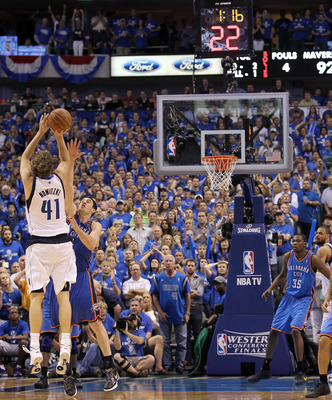 DALLAS, TX - MAY 25:  Dirk Nowitzki #41 of the Dallas Mavericks makes a three-pointer in the fourth quarter over Nick Collison #4 of the Oklahoma City Thunder in Game Five of the Western Conference Finals during the 2011 NBA Playoffs at American Airlines