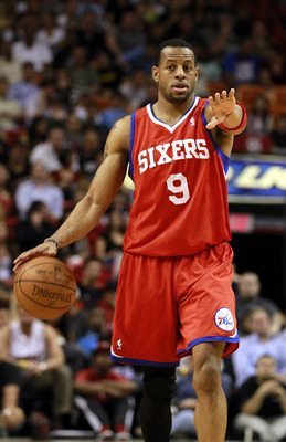 MIAMI, FL - MARCH 25:  Guard Andr Iguodala #9 of the Philadelphia Sixers brings up the ball against the Miami Heat at American Airlines Arena on March 25, 2011 in Miami, Florida. The Heat defeated the Sixers 111-99. NOTE TO USER: User expressly acknowledg