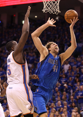 OKLAHOMA CITY, OK - MAY 23:  Dirk Nowitzki #41 of the Dallas Mavericks goes up for a shot against Kendrick Perkins #5 of the Oklahoma City Thunder in the first half of Game Four of the Western Conference Finals during the 2011 NBA Playoffs at Oklahoma Cit