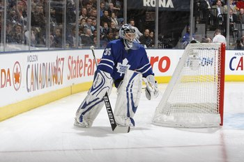 TORONTO - DECEMBER 16:  Goaltender Vesa Toskala #35 of the Toronto Maple Leafs skates his net during their NHL game against the Phoenix Coyotes at the Air Canada Centre on December 16, 2009 in Toronto, Ontario, Canada.(Photo By Dave Sandford/Getty Images)