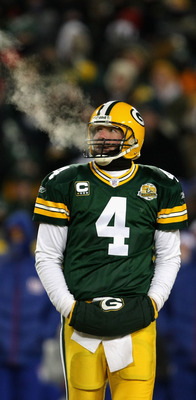 GREEN BAY, WI - JANUARY 20:  Quarterback Brett Favre #4 of the Green Bay Packers warms his hand in between plays of the NFC championship game against the New York Giants on January 20, 2008 at Lambeau Field in Green Bay, Wisconsin.  (Photo by Jonathan Dan