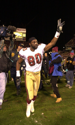 23 Dec 2000:  Jerry Rice #80 of the San Francisco 49ers waves to fans at the end of the game as he leaves the field, in perhaps his last game as a 49er, against the Denver Broncos at Mile High Stadium in Denver, Colorado.  The Broncos won 38-9.  DIGITAL I