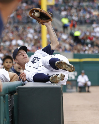 DETROIT - MAY 14: Brandon Inge #15 of the Detroit Tigers catches a foul ball against the stands off the bat of Brayan Pena #27 of the Kansas City Royals in the second inning of the game at Comerica Park on May 14, 2011 in Detroit, Michigan.  (Photo by Leo