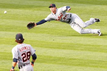CLEVELAND - APRIL 30: Brennan Boesch #26 of the Detroit Tigers attempts to make a diving catch in front of teammate Will Ryhmes #28 during the game against the Cleveland Indians on April 30, 2011 at Progressive Field in Cleveland, Ohio.  (Photo by Jared W