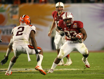 MIAMI, FL - JANUARY 03:  Stepfan Taylor #33 of the Stanford Cardinal runs the ball in the second half against the Virginia Tech Hokies during the 2011 Discover Orange Bowl at Sun Life Stadium on January 3, 2011 in Miami, Florida. Stanford won 40-12. (Phot