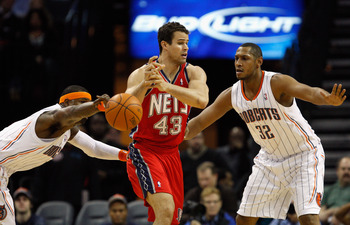 CHARLOTTE, NC - FEBRUARY 11:  Kris Humphries #43 of the New Jersey Nets has the ball knocked loose by Stephen Jackson #1 of the Charlotte Bobcats as teammate Boris Diaw #32 watches on during their game at Time Warner Cable Arena on February 11, 2011 in Ch