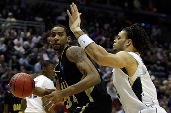 MILWAUKEE - MARCH 19:  Keith Benson #34 of the Oakland Golden Grizzlies drives on Gary McGhee #52 of the of the Pittsburgh Panthers in the first half during the first round of the 2010 NCAA men's basketball tournament at the Bradley Center on March 19, 20