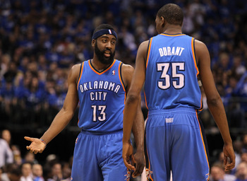 DALLAS, TX - MAY 19:  James Harden #13 of the Oklahoma City Thunder talks with Kevin Durant #35 in the first half while taking on the Dallas Mavericks in Game Two of the Western Conference Finals during the 2011 NBA Playoffs at American Airlines Center on