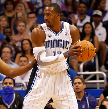 ORLANDO, FL - APRIL 26:  Jason Collins #34 of the Atlanta Hawks guards Dwight Howard #12 of the Orlando Magic during Game Five of the Eastern Conference Quarterfinals of the 2011 NBA Playoffs on April 26, 2011 at the Amway Arena in Orlando, Florida.  NOTE
