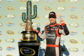 AVONDALE, AZ - FEBRUARY 27:  Jeff Gordon, driver of the #24 Drive to End Hunger Chevrolet, celebrates in victory lane after winning the NASCAR Sprint Cup Series Subway Fresh Fit 500 at Phoenix International Raceway on February 27, 2011 in Avondale, Arizon