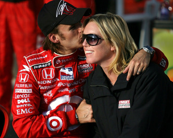 KANSAS CITY, KS - APRIL 27:  Dan Wheldon in the #10 Target Chip Ganassi Racing car kisses his wife Susie as he celebrates his win during the Road Runner Turbo Indy 300 at the Kansas Speedway on April 27, 2008 in Kansas City, Kansas.  (Photo by Marc Serota