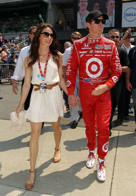 INDIANAPOLIS - MAY 30:  Scott Dixon of New Zealand, driver of the #9 Target Chip Ganassi Racing Dallara Honda, and his wife Emma walk in gasoline alley during the IZOD IndyCar Series 94th running of the Indianapolis 500 at the Indianapolis Motor Speedway