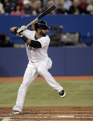 TORONTO, CANADA - MAY 18: Jose Bautista #19 of the Toronto Blue Jays hits against the Tampa Bay Rays during MLB action at the Rogers Centre May 18, 2011 in Toronto, Ontario, Canada. (Photo by Abelimages/Getty Images)
