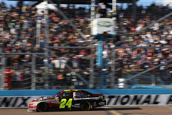 AVONDALE, AZ - FEBRUARY 27:  Jeff Gordon, driver of the #24 Drive to End Hunger Chevrolet, crosses the finish line to win the NASCAR Sprint Cup Series Subway Fresh Fit 500 at Phoenix International Raceway on February 27, 2011 in Avondale, Arizona.  (Photo