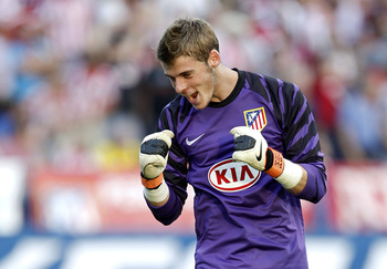 MADRID, SPAIN - SEPTEMBER 19:  David de Gea of Atletico Madrid celebrates after team mate Raul Garcia scored his team's first goal during the La Liga match between Atletico Madrid and Barcelona at Vicente Calderon Stadium on September 19, 2010 in Madrid,