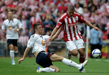 LONDON, ENGLAND - APRIL 17:  Gary Cahill of Bolton battles with Jonathan Walters of Stoke during the FA Cup sponsored by E.ON semi final match between Bolton Wanderers and Stoke City at Wembley Stadium on April 17, 2011 in London, England.  (Photo by Ross
