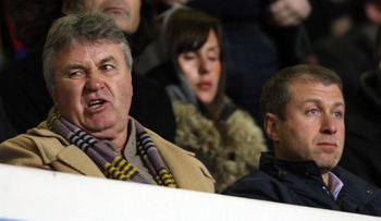 BIRMINGHAM, UNITED KINGDOM - FEBRUARY 18:  Guus Hiddink, manager of Chelsea and owner Roman Abramovich at the UEFA Cup match between Aston Villa and CSKA Moscow at Villa Park on February 18, 2009 in Birmingham, England.  (Photo by Ross Kinnaird/Getty Imag