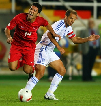 ISTANBUL, TURKEY - OCTOBER 17: Angelos Basinas of Greece (r) battles with Turkey forward Arda Turan during the Euro 2008 Qualifying match between Turkey and Greece at Ali Sami Yen Stadium on October 17, 2007 in Istanbul,Turkey.  (Photo by Stu Forster/Gett