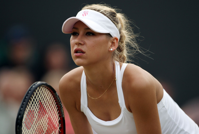 LONDON, ENGLAND - JUNE 29:  Anna Kournikova of Russia in action during her Ladies Invitational doubles match against Anne Hobbs and Samantha Smith of Great Britain on Day Eight of the Wimbledon Lawn Tennis Championships at the All England Lawn Tennis and