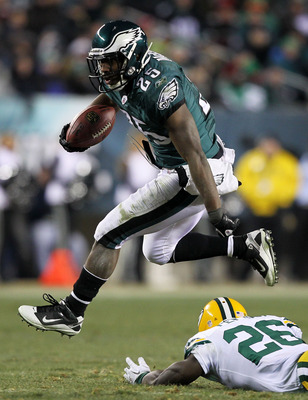 PHILADELPHIA, PA - JANUARY 09:  LeSean McCoy #25 of the Philadelphia Eagles avoids the tackle of Charlie Peprah #26 of the Green Bay Packers during the 2011 NFC wild card playoff game at Lincoln Financial Field on January 9, 2011 in Philadelphia, Pennsylv