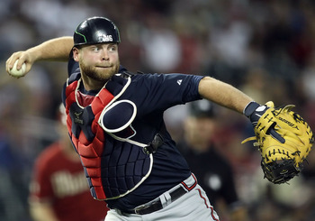 PHOENIX, AZ - MAY 18:  Catcher Brian McCann #16 of the Atlanta Braves in action during the Major League Baseball game against the Arizona Diamondbacks at Chase Field on May 18, 2011 in Phoenix, Arizona.  The Diamondbacks defeated the Braves 5-4 in eleven