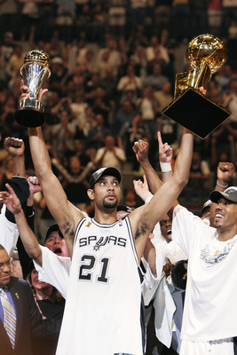 SAN ANTONIO - JUNE 23:  Tim Duncan #21 of the San Antonio Spurs celebrates with the Finals MVP Trophy and the Larry O'Brien Trophy after defeating the Detroit Pistons in Game seven of the 2005 NBA Finals at SBC Center on June 23, 2005 in San Antonio, Texa