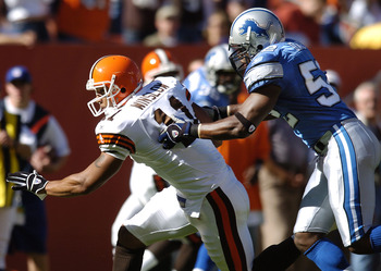 CLEVELAND, OH - AUGUST 21:  Tight end Kellen Winslow Jr. #11 of the Cleveland Browns catches a pass for a first down against linebacker James Davis #52 of the Detroit Lions during their pre-season game on August 21, 2004 at Cleveland Browns Stadium in Cle