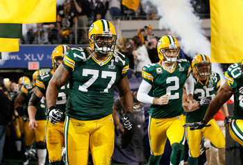ARLINGTON, TX - FEBRUARY 06: Cullen Jenkins #77 and Mason Crosby #2 of the Green Bay Packers run onto the field prior to Super Bowl XLV at Cowboys Stadium on February 6, 2011 in Arlington, Texas.  (Photo by Kevin C. Cox/Getty Images)