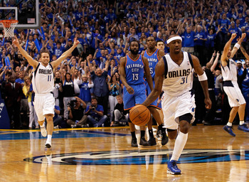 DALLAS, TX - MAY 25:  Jason Terry #31 of the Dallas Mavericks moves the ball down court as Jose Juan Barea #11 celebrates as the the Mavericks defeat the the Oklahoma City Thunder 100-96 in Game Five of the Western Conference Finals during the 2011 NBA Pl