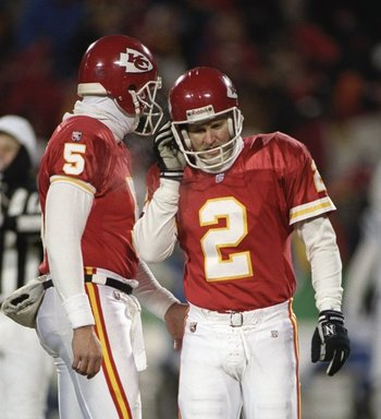 7 Jan 1996: Kansas City Chiefs punter Louis Aguiar consoles teammate kicker Lin Elliott after he missed a field goal during a playoff game against the Indianapolis Colts at Arrowhead Stadium in Kansas City, Missouri. The Colts won the game, 10-7.