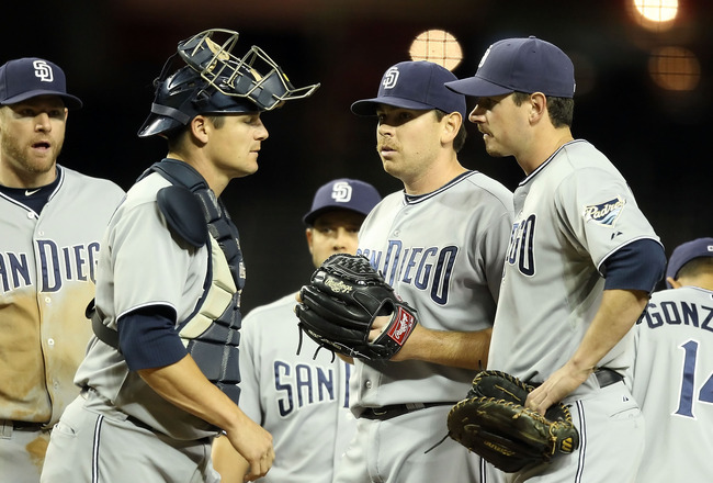 PHOENIX, AZ - MAY 17:  Starting pitcher Tim Stauffer #46 of the San Diego Padres stands on the mound with teammates before being removed from the Major League Baseball game against the Arizona Diamondbacks at Chase Field on May 17, 2011 in Phoenix, Arizon
