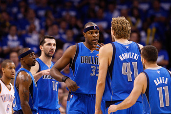 OKLAHOMA CITY, OK - MAY 21:  (L-R) Jason Terry #31, Peja Stojakovic #16, Brendan Haywood #33, Dirk Nowitzki #41 and Jose Juan Barea #11 of the Dallas Mavericks celebrate on the court in the second quarter while taking on the Oklahoma City Thunder in Game
