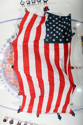 UNIONDALE, NY - NOVEMBER 17:  A large American flag is unfurled prior to the game between the New York Islanders and the Tampa Bay Lightning at the Nassau Coliseum on November 17, 2010 in Uniondale, New York. The Lightning defeated the Islanders 4-2. (Pho