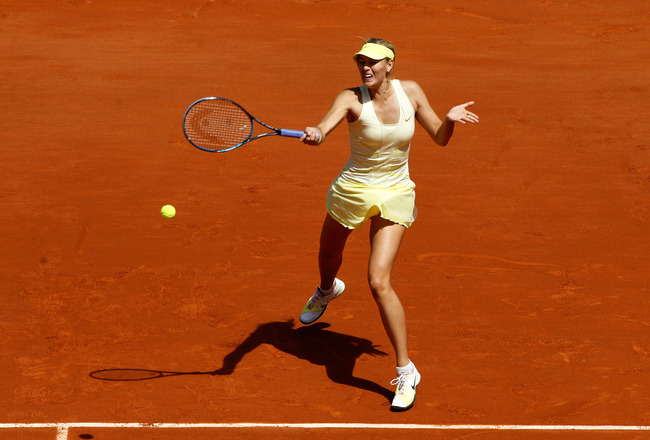 PARIS, FRANCE - MAY 24:  Maria Sharapova of Russia plays a forehand during the women's singles round one match between Maria Sharapova of Russia and Mirjana Lucic of Croatia on day three of the French Open at Roland Garros on May 24, 2011 in Paris, France