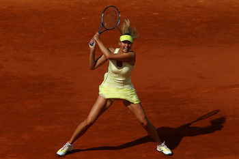 PARIS, FRANCE - MAY 26:  Maria Sharapova of Russia hits a backhand during the women's singles round two match between Maria Sharapova of Russia and Caroline Garcia of France on day five of the French Open at Roland Garros on May 26, 2011 in Paris, France.