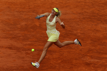 PARIS, FRANCE - MAY 26:  Maria Sharapova of Russia hits a forehand during the women's singles round two match between Maria Sharapova of Russia and Caroline Garcia of France on day five of the French Open at Roland Garros on May 26, 2011 in Paris, France.