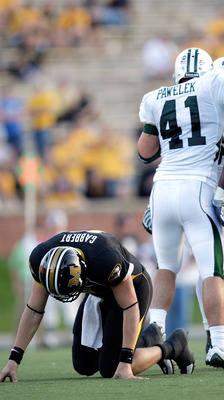 COLUMBIA, MO - NOVEMBER 07:  Baylor Bears players celebrate after sacking quarterback Blaine Gabbert #11 of the Missouri Tigers during the second half of the game at Faurot Field at Memorial Stadium on November 7, 2009 in Columbia, Missouri.  (Photo by Ja