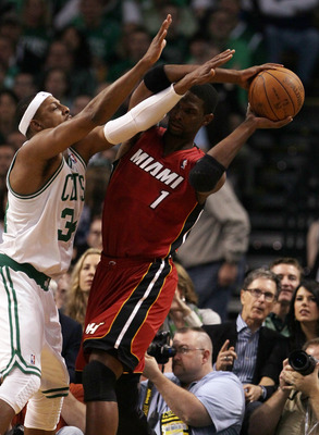 BOSTON, MA - MAY 07:  Chris Bosh #1 of the Miami Heat tries to get around Paul Pierce #34 of the Boston Celtics  in Game Three of the Eastern Conference Semifinals in the 2011 NBA Playoffs on May 7, 2011 at the TD Garden in Boston, Massachusetts.  NOTE TO