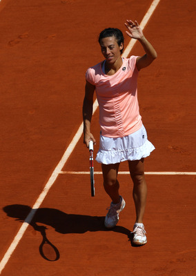 PARIS, FRANCE - MAY 23:  Francesca Schiavone of Italy celebrates match point during the women's singles round one match between Melanie Oudin of USA and Francesca Schiavone of Italy on day two of the French Open at Roland Garros on May 23, 2011 in Paris,