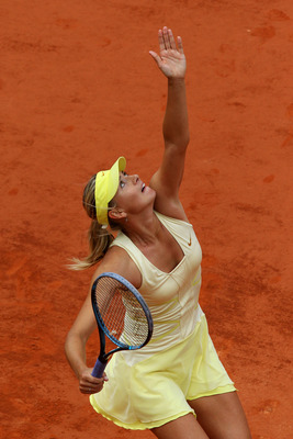 PARIS, FRANCE - MAY 26:  Maria Sharapova of Russia serves during the women's singles round two match between Maria Sharapova of Russia and Caroline Garcia of France on day five of the French Open at Roland Garros on May 26, 2011 in Paris, France.  (Photo