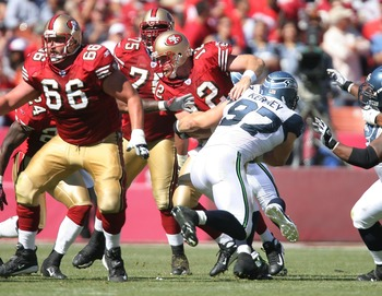Dilfer playing QB for the 49ers in 2007 is sacked by Patrick Kerney.